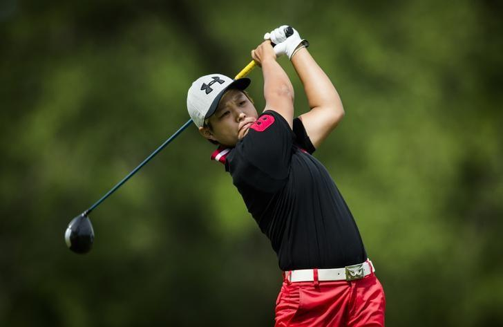 Haru Nomura of Japan tees off the fifth hole during the second round of the Manulife Financial LPGA Classic women's golf tournament at the Grey Silo course in Waterloo, June 6, 2014.    REUTERS/Mark Blinch