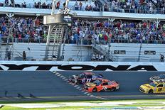 Feb 21, 2016; Daytona Beach, FL, USA; NASCAR Sprint Cup Series driver Denny Hamlin (11) beats NASCAR Sprint Cup Series driver Martin Truex Jr. (78) to win the Daytona 500 at Daytona International Speedway. Mandatory Credit: Jasen Vinlove-USA TODAY Sports