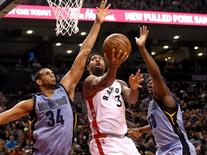 Feb 21, 2016; Toronto, Ontario, CAN; Toronto Raptors guard Terrence Ross (31) drives to the basket between Memphis Grizzlies forwards Brandan Wright (34) and Zach Randolph (50) in the second half of the Raptors 98-85 win  at Air Canada Centre. Mandatory Credit: Dan Hamilton-USA TODAY Sports