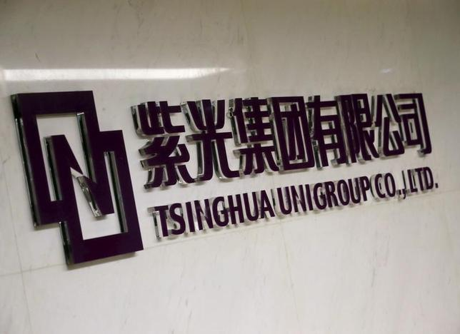The logo of Tsinghua Unigroup is seen at its office in Beijing, China, November 15, 2015. REUTERS/Kim Kyung-Hoon