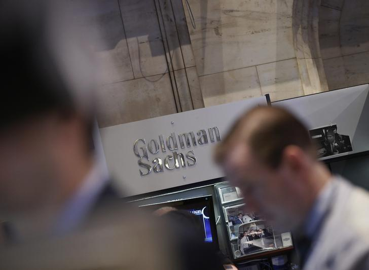 A Goldman Sachs sign is seen over the company's trading stall on the floor at the New York Stock Exchange, March 21, 2013. REUTERS/Brendan McDermid/Files