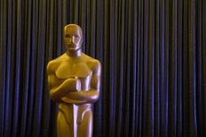 An Oscar statue stands in front of a curtain during a press event for Foreign Language Film Award nominees leading up to the 87th Academy Awards in Hollywood, California February 20, 2015. REUTERS/Lucas Jackson