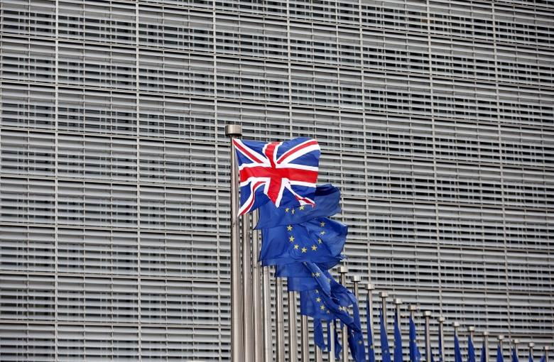 A Union Jack flag flutters next to European Union flags ahead of a visit from Britain's Prime Minister David Cameron at the EU Commission headquarters in Brussels, Belgium, in this January 29, 2016 file photo. REUTERS/Francois Lenoir/Files