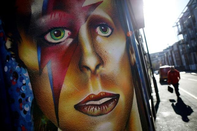 A man walks towards a mural of David Bowie in Sheffield, Britain February 3, 2016.  REUTERS/Darren Staples