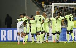 Jogadores do Manchester City comemoram gol marcado contra o Dynamo Kiev pela Liga dos Campeões. 24/02/2016 REUTERSGleb Garanich