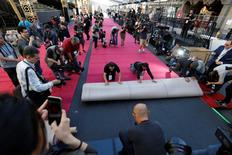 Red carpet is rolled out outside the Dolby theatre during preparations leading up to the 88th Academy Awards in Hollywood, California February 24, 2016. REUTERS/Mario Anzuoni