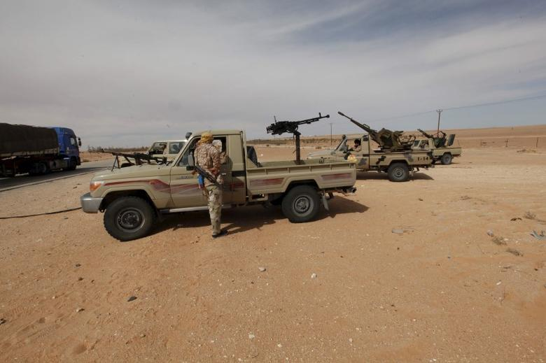 Libyan military vehicles are pictured at a checkpoint in Wadi Bey, west of the Islamic State-held city of Sirte, February 23, 2016. REUTERS/Ismail Zitouny
