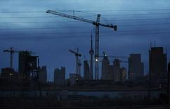 Construction cranes being used to build condominium buildings are seen along the skyline in Toronto December 6, 2012. REUTERS/Mark Blinch