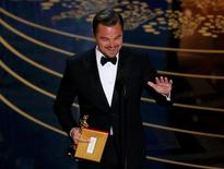 "Leonardo DiCaprio accepts the Oscar for Best Actor for the movie ""The Revenant"" at the 88th Academy Awards in Hollywood, California February 28, 2016.  REUTERS/Mario Anzuoni"