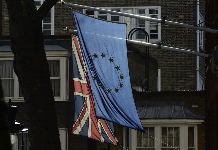 A British Union flag and a European Union flag hang from a building in central London, Britain February 18, 2016. REUTERS/Toby Melville