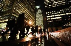 People walk down Bay St in the heart of the financial district in downtown Toronto in this file photo taken on December 7, 2009. REUTERS/Mark Blinch