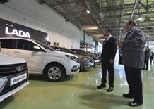 Russian Prime Minister Dmitry Medvedev (L) visits the plant of carmaker AvtoVAZ in Togliatti, Russia, January 22, 2016. Medvedev said on Friday that he had signed a decree to provide 50 billion roubles ($631.35 million) in government subsidies to the country's troubled car industry. REUTERS/Alexander Astafyev/Sputnik/Pool ATTENTION EDITORS - THIS IMAGE HAS BEEN SUPPLIED BY A THIRD PARTY. IT IS DISTRIBUTED, EXACTLY AS RECEIVED BY REUTERS, AS A SERVICE TO CLIENTS.   - RTX23JMP