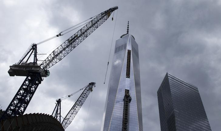 The One World Trade Center tower and Seven World Trade Center (R) are seen towering over lower Manhattan in New York May 2, 2014. REUTERS/Brendan McDermid