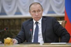 En la imagen, el presidente ruso, Vladimir Putin, asiste al Consejo Estatal Supremo del Estado de la Unión de Rusia y Bielorrusia en Minsk, Bielorrusia. 25 febrero 2016. Putin dijo el miércoles que los productores locales de petróleo acordaron mantener la producción de crudo del 2016 en línea con los niveles de enero, en momentos en que Moscú busca apuntalar los débiles precios de la energía. REUTERS/Alexei Druzhinin/Sputnik/Kremlin