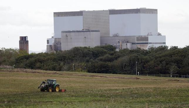 A tractor mows a field on the site where EDF Energy's Hinkley Point C nuclear power station will be constructed in Bridgwater, southwest England October 24, 2013. REUTERS/Suzanne Plunkett