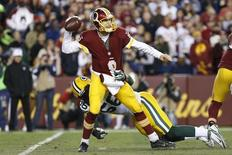 Jan 10, 2016; Landover, MD, USA; Washington Redskins quarterback Kirk Cousins (8) throws the ball as Green Bay Packers outside linebacker Julius Peppers (56) defends during the first half in a NFC Wild Card playoff football game at FedEx Field. Mandatory Credit: Geoff Burke-USA TODAY Sports