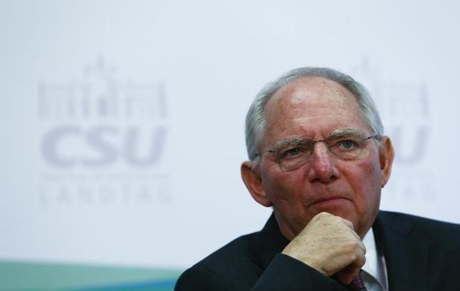 German Finance Minister Wolfgang Schaeuble speaks to media ahead of the Christian Social Union (CSU) meeting in the southern Bavarian resort of Wildbad Kreuth near Munich, Germany, January 20, 2016. REUTERS/Michaela Rehle