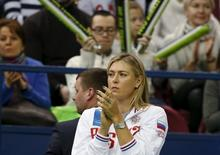 Russia's Maria Sharapova reacts as she watches compatriot Ekaterina Makarova play against Kiki Bertens of the Netherlands during their Fed Cup World Group tennis match in Moscow, February 6, 2016.  REUTERS/Grigory Dukor