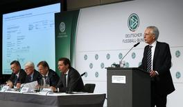 German Football Association (DFB) designated president Reinhard Grindel, interim presidents Reinhard Rauball and Rainer Koch and media director Ralf Koettker (L-2nd R) listen as Freshfields lawyer Christian Duve addresses a news conference in Frankfurt, Germany March 4, 2016, to present an independent report commissioned by the DFB into the 2006 World Cup and the scandal involving a payment to world soccer's governing body FIFA, allegedly to ensure the World Cup was awarded to Germany. REUTERS/Kai Pfaffenbach