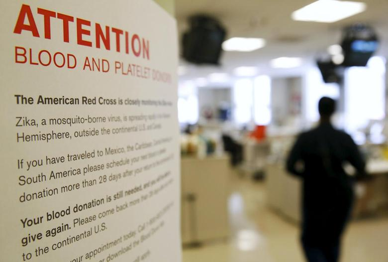 A sign explaining the parameters concerning the Zika virus and blood donations is seen at the American Red Cross Charles Drew Donation Center in Washington February 16, 2016.   REUTERS/Gary Cameron