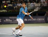 Novak Djokovic of Serbia returns the ball to Feliciano Lopez of Spain during their match at the ATP Dubai Duty Free Tennis Championships February 25, 2016. REUTERS/Ahmed Jadallah