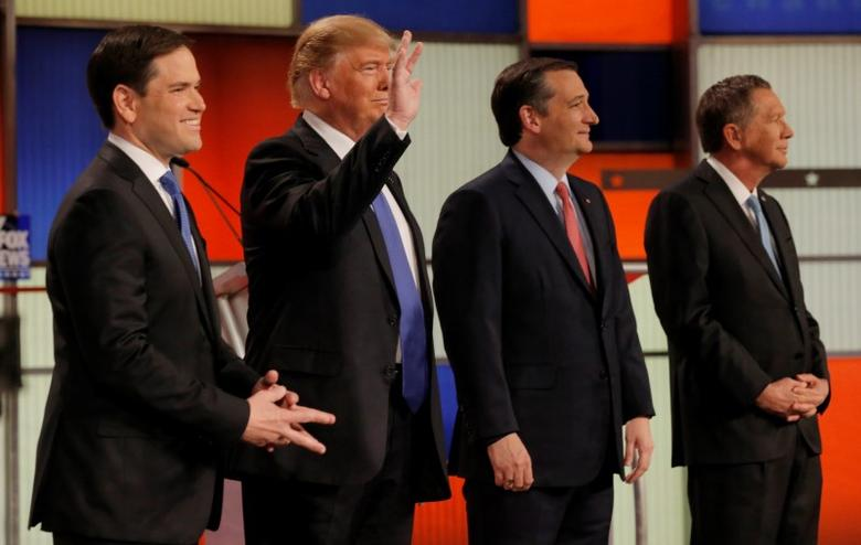 Republican U.S. presidential candidates (L-R) Marco Rubio, Donald Trump, Ted Cruz and John Kasich pose together at the start of the U.S. Republican presidential candidates debate in Detroit, Michigan, March 3, 2016. REUTERS/Jim Young