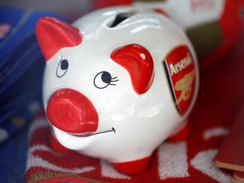 A piggy bank branded with the logo of the English Premier League soccer club Arsenal is seen in a souvenir shop in London October 18, 2011.  REUTERS/Chris Helgren