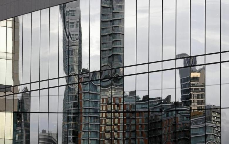 Scyscrapers of banks at Canary Wharf in London are refected, Britain October 30, 2015. REUTERS/Reinhard Krause