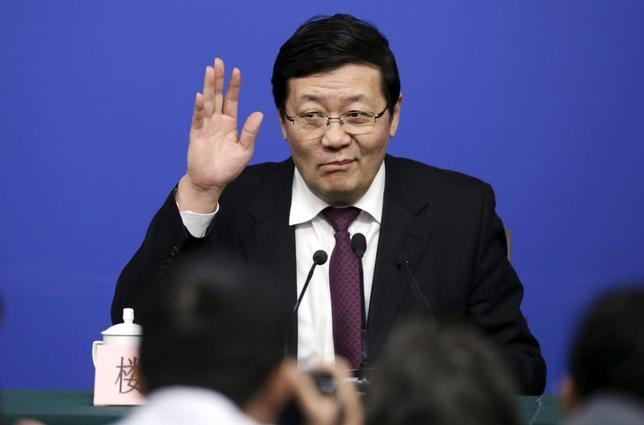 China's Finance Minister Lou Jiwei gestures to the media as he arrives for a news conference during the ongoing National People's Congress (NPC), China's parliament, in Beijing, China March 7, 2016.  REUTERS/Jason Lee