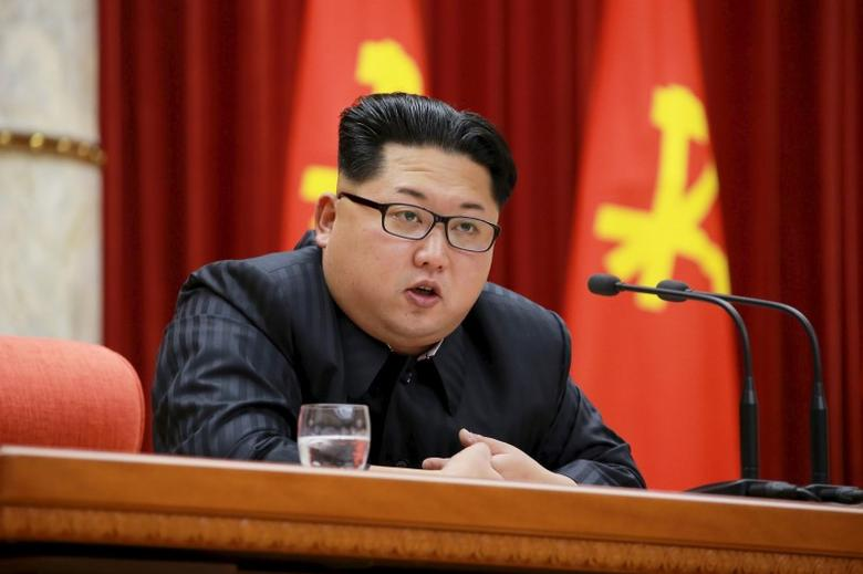 North Korean leader Kim Jong Un speaks during a ceremony to award party and state commendations to nuclear scientists, technicians, soldier-builders, workers and officials for their contribution to what North Korea said was a successful hydrogen bomb test, at the meeting hall of the Central Committee of the Workers' Party of Korea (WPK) in this undated photo released January 13, 2016. REUTERS/KCNA