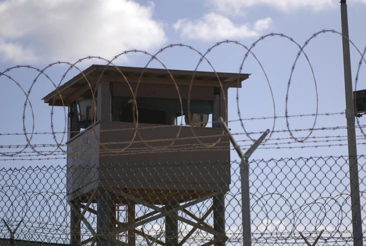 A soldier stands guard in a tower overlooking Camp Delta  at Guantanamo Bay naval base in a December 31, 2009 file photo provided by the US Navy. REUTERS/US Navy/Spc. Cody Black/Handout via Reuters