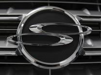 A logo of Ssangyong Motor is seen on the automaker's sport utility vehicle 'Kyron' displayed for customers at the company's branch shop in Seoul August 12, 2010.  REUTERS/Jo Yong-Hak/Files