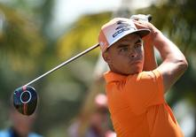 Rickie Fowler follows his drive off the second tee during the final round at TPC Blue Monster at Trump National Doral. Mandatory Credit: John David Mercer-USA TODAY Sports