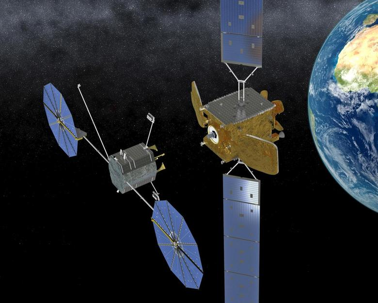 Orbital ATK's Mission Extension Vehicle (MEV) shown in this artist's rendering can safely connect to an orbiting satellite in order to provide supplemental attitude and maneuvering capabilities without disruption to the client satellite's operation. The MEV can add years to the revenue producing life of a satellite.  REUTERS/Orbital ATK/Handout via Reuters