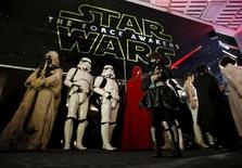 """Moviegoers wait before the first showing of the movie """"Star Wars: The Force Awakens"""" at the entrance of a movie theatre in Tokyo, Japan, December 18, 2015. REUTERS/Issei Kato"""