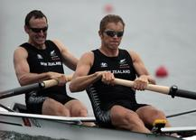 Nathan Twaddle (L) and George Bridgewater of New Zealand competes during the men's pair semifinal rowing competition at the Beijing 2008 Olympic Games in Shunyi Rowing-Canoeing Park August 13, 2008.     REUTERS/Aly Song