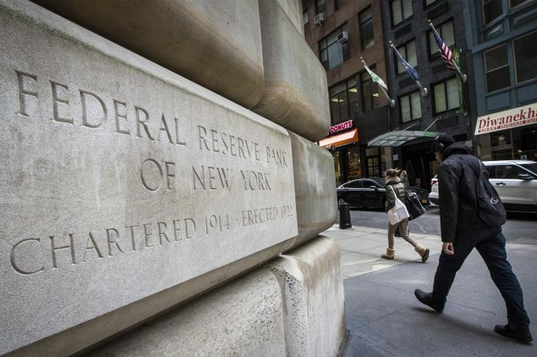 The corner stone of The New York Federal Reserve Bank is seen in New York's financial district March 25, 2015. The Federal Reserve should remain on track to raise interest rates later this year despite the U.S. economy's weak start to the year and a stock market sell-off this week, two Fed officials said on Thursday. REUTERS/Brendan McDermid  - RTR4V0ES