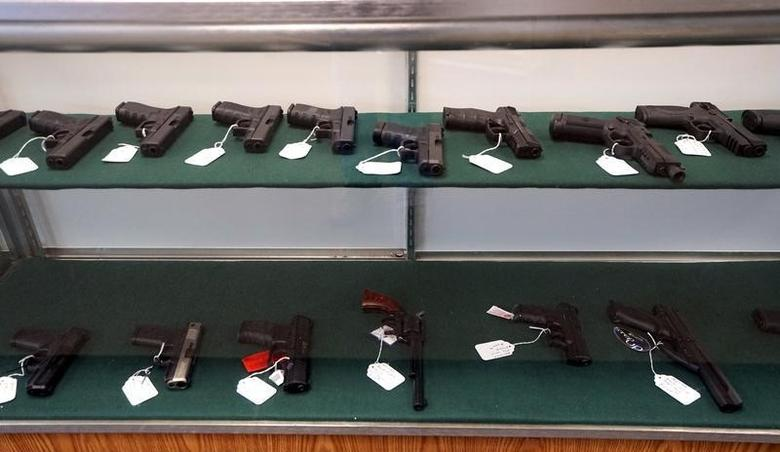 A selection of handguns are seen for sale at the Pony Express Firearms shop in Parker, Colorado December 7, 2015. Many Americans are stocking up on weapons after the country's worst mass shooting in three years. Gun retailers are reporting surging sales, with customers saying they want to keep handguns and rifles at hand for self-defense in the event of another attack. REUTERS/Rick Wilking - RTX1XMR9