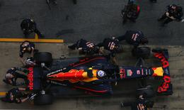 Red Bull Formula One driver Daniel Ricciardo of Australia makes a pit stop during the second testing session ahead the upcoming season at the Circuit Barcelona-Catalunya in Montmelo, Spain, February 23, 2016. REUTERS/Sergio Perez