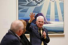"Guest curator actor Steve Martin talks about the paintings of Canadian artist Lawren Harris during a media preview of a new exhibit of Harris' works ""The Idea of North"" at the Museum of Fine Arts, Boston in Boston, Massachusetts March 11, 2016.   REUTERS/Brian Snyder"