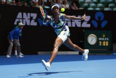 Venus Williams of the U.S. runs to hit a shot during her first round match against Britain's Johanna Konta at the Australian Open tennis tournament at Melbourne Park, Australia, January 19, 2016. REUTERS/Thomas Peter