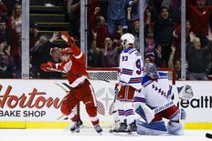Mar 12, 2016; Detroit, MI, USA; Detroit Red Wings center Darren Helm (43) celebrates his overtime goal on New York Rangers goalie Henrik Lundqvist (30) in front of defenseman Keith Yandle (93) at Joe Louis Arena. Detroit won 3-2 in overtime. Mandatory Credit: Rick Osentoski-USA TODAY Sports