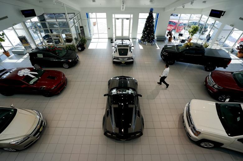 New cars are seen on the showroom floor at the Medved dealer in Denver December 16, 2015. REUTERS/Rick Wilking