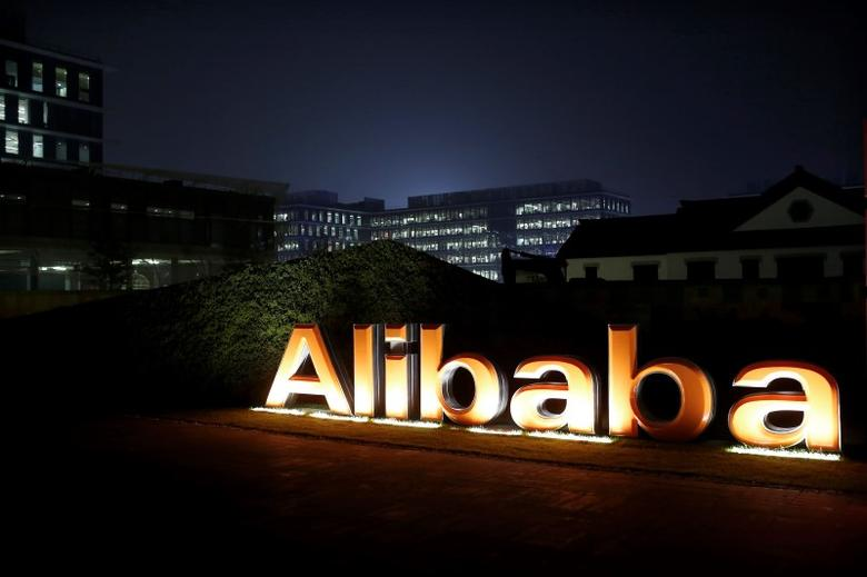 The logo of Alibaba Group is seen inside the company's headquarters in Hangzhou, Zhejiang province early November 11, 2014.  REUTERS/Aly Song