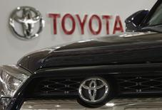 A logo of Toyota Motor Corp is pictured on a car and the background at the company's showroom in Tokyo, Japan, June 16, 2015. REUTERS/Yuya Shino