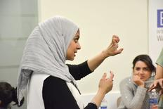 Egyptian-American community activist Rana Abdelhamid demonstrates how to hold one's fist for an attack punch during a self-defense workshop designed for Muslim women in Washington, DC, March 4, 2016 in this handout photo provided by Rawan Elbaba. Picture taken March 4, 2016. REUTERS/Rawan Elbaba/Handout via Reuters