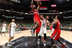 Portland Trail Blazers power forward Noah Vonleh (21) dunks the ball as San Antonio Spurs power forward Tim Duncan (21) looks on during the second half at AT&T Center. Mandatory Credit: Soobum Im-USA TODAY Sports