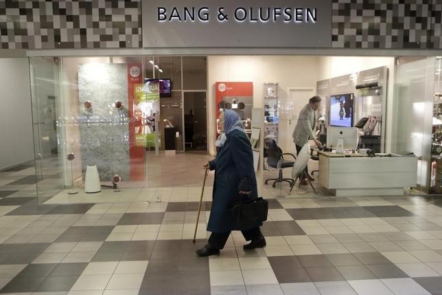 A woman walks past a Bang & Olufsen shop in Riga October 1, 2013. REUTERS/Ints Kalnins
