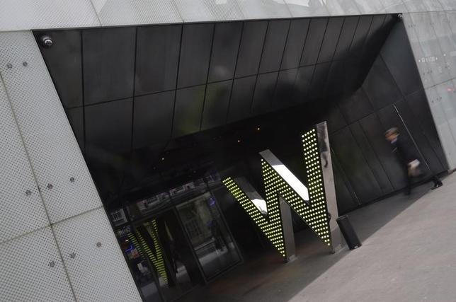 A man walks into the 'W London' hotel, owned by Starwood Hotels, in Leicester Square in central London March 4, 2014. REUTERS/Toby Melville