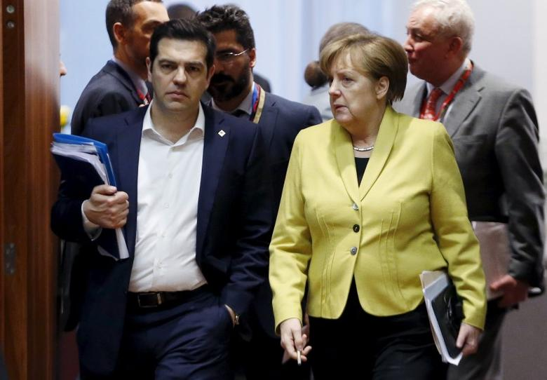 Greece's Prime Minister Alexis Tsipras and Germany's Chancellor Angela Merkel (R) attend a European Union leaders summit on migration in Brussels, Belgium, March 18, 2016. REUTERS/Francois Lenoir